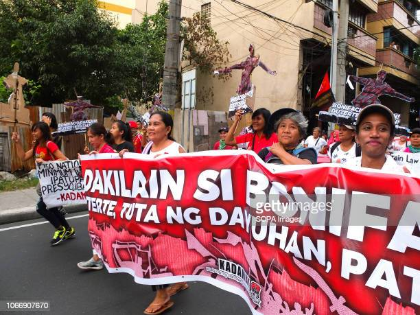 Protesters are seen holding a banner during the protest Leftist groups stage Bonifacio Day of protest in Mendiola and at the US Embassy in Manila on...