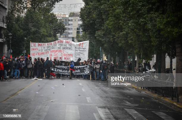 Protesters are seen holding a banner during the protest Protest to mark the 10th Anniversary of Alexis Grigoropoulos he was shot fatally by a police...