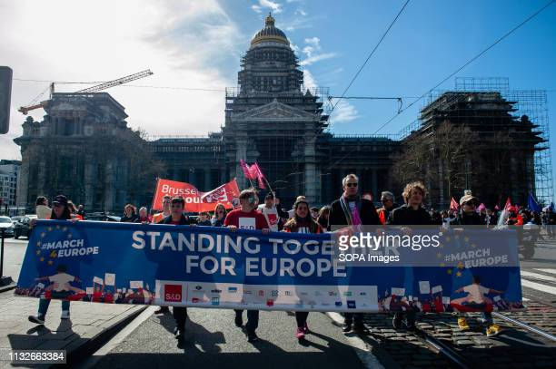 Protesters are seen holding a banner while shouting slogans during the protest A day before the anniversary of the founding Treaty of the European...