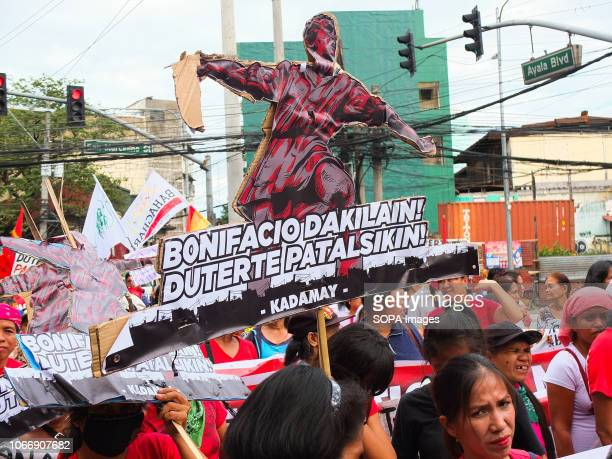 Protesters are seen holding a cardboard replica of Andres Bonifacio during the protest Leftist groups stage Bonifacio Day of protest in Mendiola and...