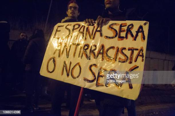 Protesters are seen holding a placard saying Spain will be antiracist or it will not be during a protest in front of the Immigration Detention Centre...