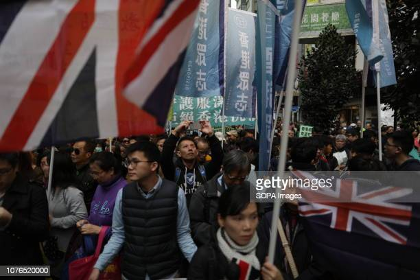 Protesters are seen holding British Union Jack flags during the Hong Kong's annual New Year's Day protest Prodemocracy protesters kicked off 2019...