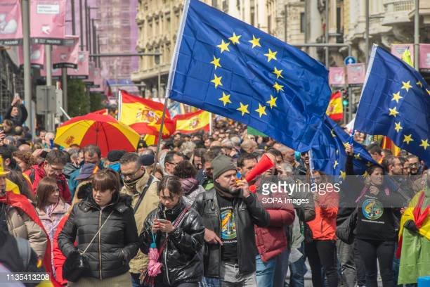 Protesters are seen holding flags during the demonstration. Thousands of policemen and civil guards have demonstrated from Puerta del Sol, passing...