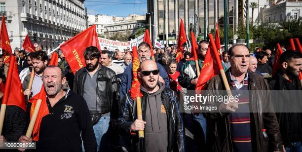 Protesters are seen holding flags while chanting slogans during a 24 hour strike Communistaffiliated PAME labor union members called for a rally in...