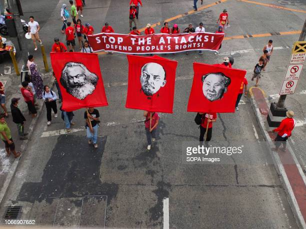MENDIOLA MANILA PHILIPPINES Protesters are seen holding flags with printed faces of Karl Marx Vladimir Lenin and Mao Zedong during the protest...