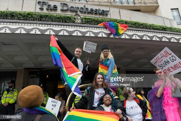 Protesters are seen holding LGBTIQ flags and placards in front of the Dorchester Hotel during the Protest condemning the new antiLGBTIQ laws brought...
