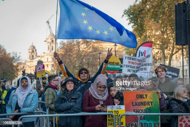 Protesters are seen holding placards and a flag during the protest Huge crowds marched from the BBC in Portland Place to Whitehall with flags and...