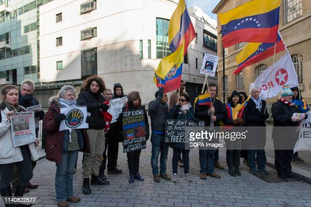 Protesters are seen holding placards and Venezuelan Colombian and Ecuadorian flags during the Hands off Venezuela protest in London Protesters...