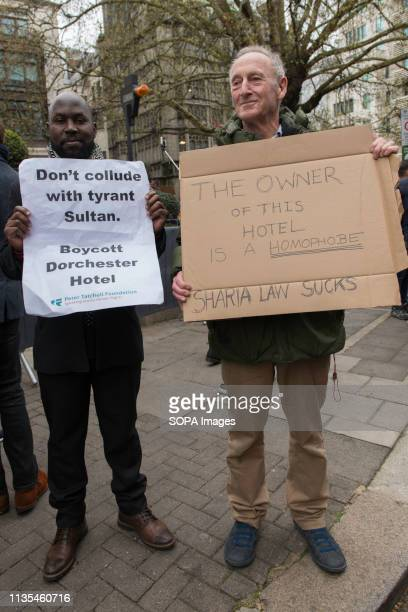 Protesters are seen holding placards during the protest condemning the new antiLGBTIQ laws brought in by the Sultan of Brunei Protesters gathered...