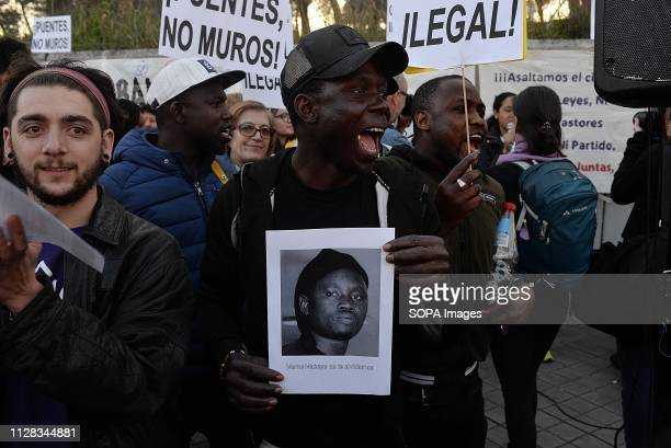 ALUCHE MADRID MADRID SPAIN Protesters are seen holding placards while chanting slogans during the protest against racism in front of the Immigrant...
