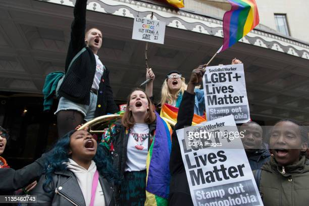 Protesters are seen holding placards while chanting slogans in front of the Dorchester Hotel during the Protest condemning the new antiLGBTIQ laws...