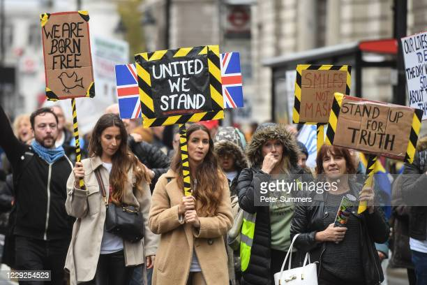 Protesters are seen in Parliament Square during a Unite for Freedom march on October 24, 2020 in London, England. Hundreds of anti-mask and...