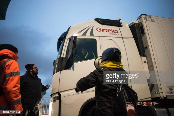 Protesters are seen informing a carrier driver about the strike and prevent him from accessing the warehouse The workers of the largest Amazon...