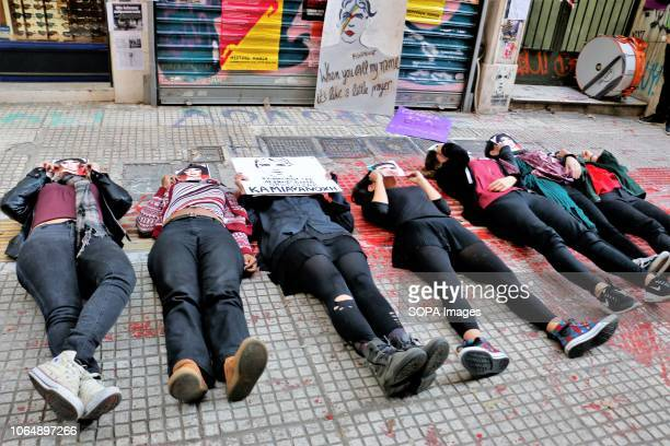 Protesters are seen lying on the ground during the protest Hundreds of women participated in the demonstration against rape sexism human trafficking...