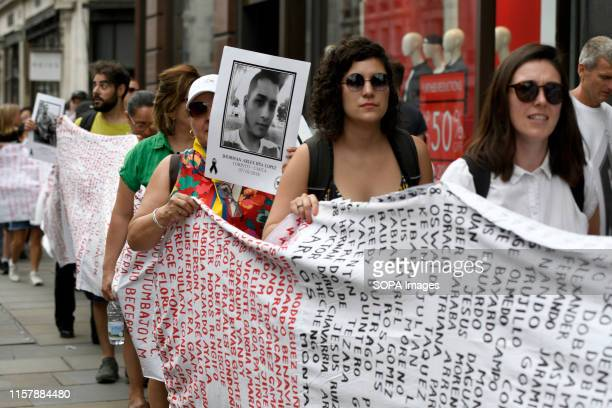 Protesters are seen marching holding a large banner with the names of sevenhundred social leaders who have been killed in Colombia in the past three...