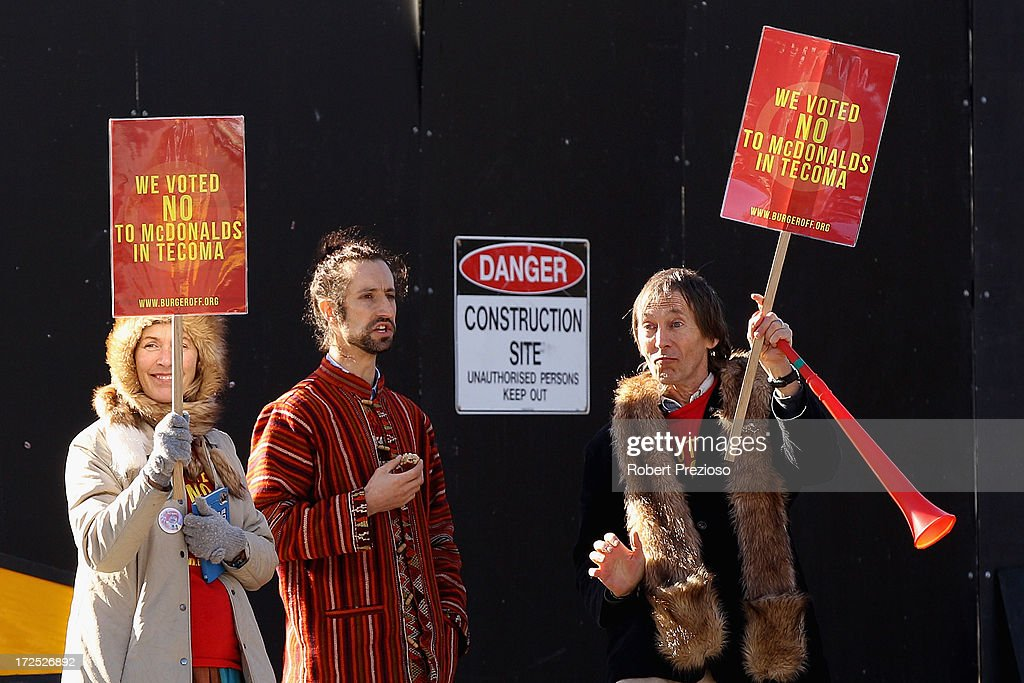 Protesters are seen on July 3, 2013 in Melbourne, Australia. Janine Watson is spending her third consecutive day on the rooftop of a building currently under proposal to be demolished, making way for a new 24 hour McDonald's restaurant, today also marks her 50th Birthday.