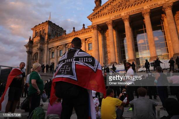 Protesters are seen outside the Reichstag during protests against coronavirus-related restrictions and government policy on August 29, 2020 in...