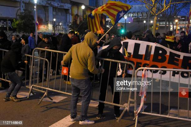 Protesters are seen removing barricades during the protest Hundreds of people demonstrate against the presence of the King of Spain Felipe VI at the...