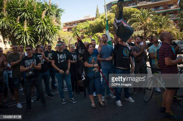 Protesters are seen shouting slogans as they take part in a protest in support of national police officers and civil guards attacked by pro...