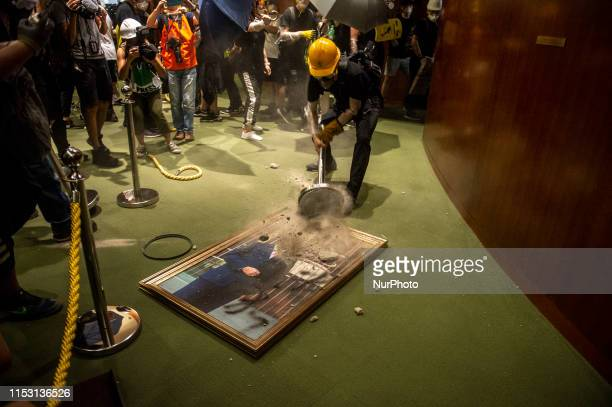 Protesters are seen smashing a portrait of Legislative Council Andrew Leung in Hong Kong China 1 July 2019 Thousands of protesters storm the...