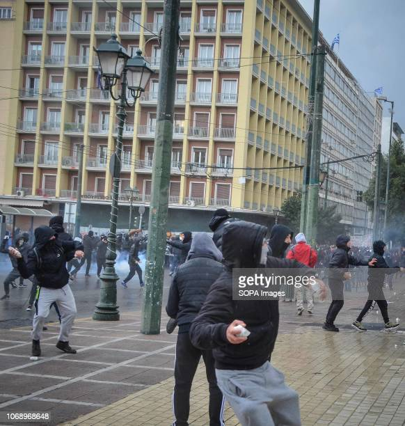 Protesters are seen throwing stones towards the Riot Police during the protest Protest to mark the 10th Anniversary of Alexis Grigoropoulos he was...