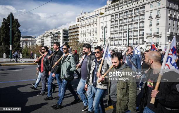 Protesters are seen walking on the street while holding flags during a 24 hour strike Communistaffiliated PAME labor union members called for a rally...