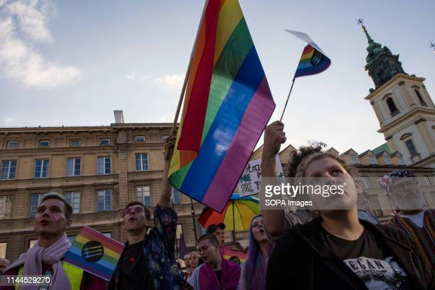 Protesters are seen waving rainbow flags during the demonstration The International Day against Homophobia Transphobia and Biphobia is celebrated...