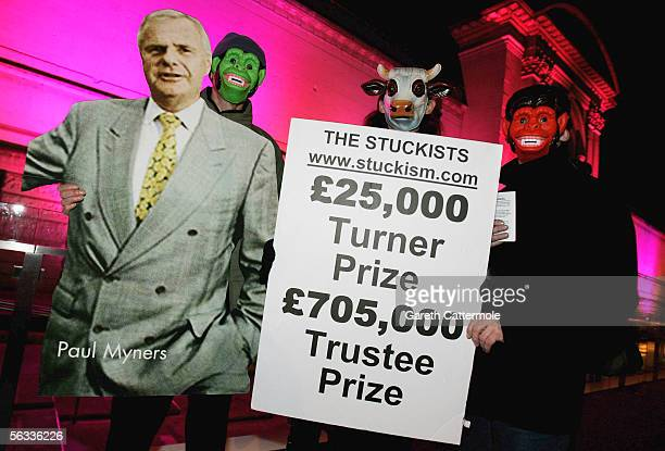 Protesters are seen with a cardboard cutout of Paul Myners the chairman of the Tate Gallery at the Turner Prize 2005 at Tate Britain on December 5...