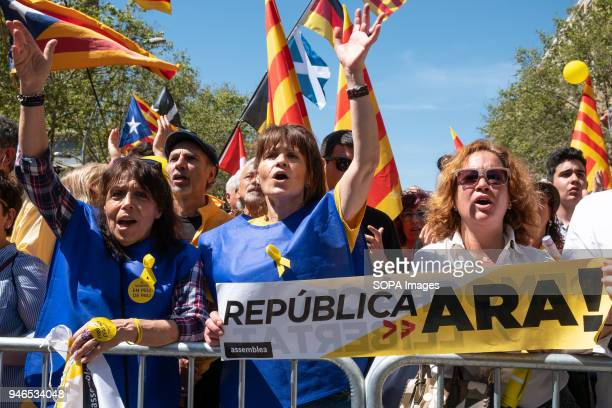 Protesters are seen with posters demanding the Catalan Republic independence Massive independence clamor on the streets of Barcelona to demand the...