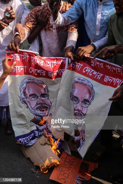 Protesters are setting fire at the cartoon banner of Narendra Modi Bangladeshi Islamic party alliance demonstrate during a rally against the recent...
