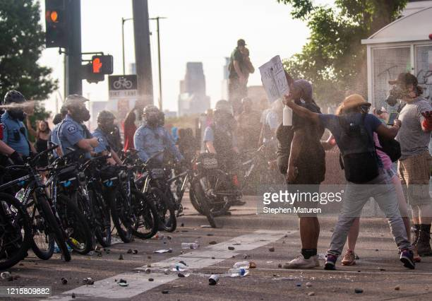 Protesters are shot with pepper spray as they confront police outside the Third Police Precinct on May 27 2020 in Minneapolis Minnesota The station...