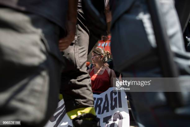 Protesters are surrounded by Italian police outside the Ministry of Transport in Rome on July 11 2018 Dozens of 'We remain human' network activists...