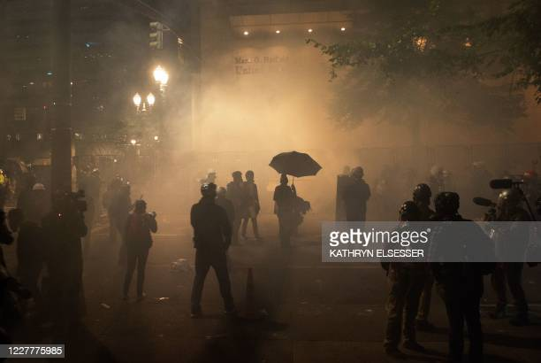 Protesters are surrounded by tear gas near the Mark O. Hatfield federal courthouse in downtown Portland as protesters take part in a rally against...