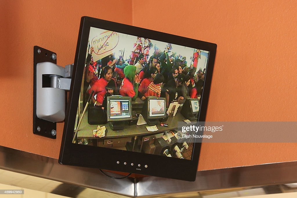 Protesters are visible on a security monitor during a take over of a Taco Bell as part of a demonstration for higher wages and better security for fast food workers on December 4, 2014 in Oakland, California. The Taco Bell has been the victim of numerous violent robberies but has no security guard. The protest was part of a nationwide day of demonstrations.