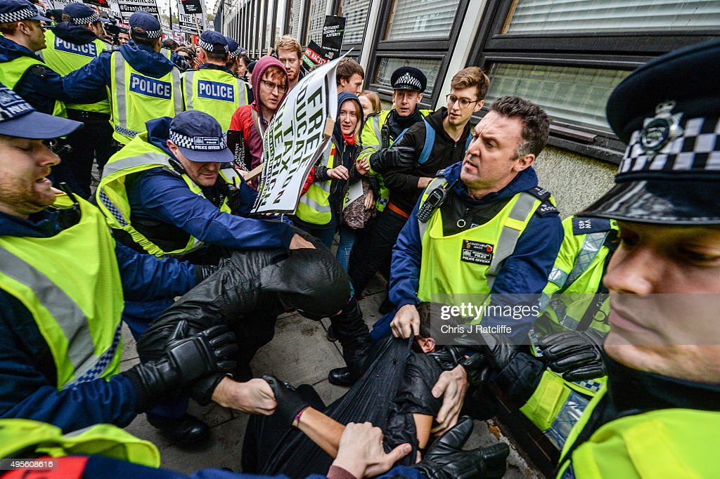 Protesters are wrestled to the ground by police as tensions flare at the Department for Business, Innovation and Skills during a demonstration against education cuts on November 4, 2015 in London, England. University students from across the country are marching on the streets of London to protest against cuts to free education. After a rally outside what was the University of London Union, the march will take in Parliament Square, Milibank - occupied by student protesters five years ago - and end in front of the Department for Business, Innovation and Skills (the department responsible for universities).