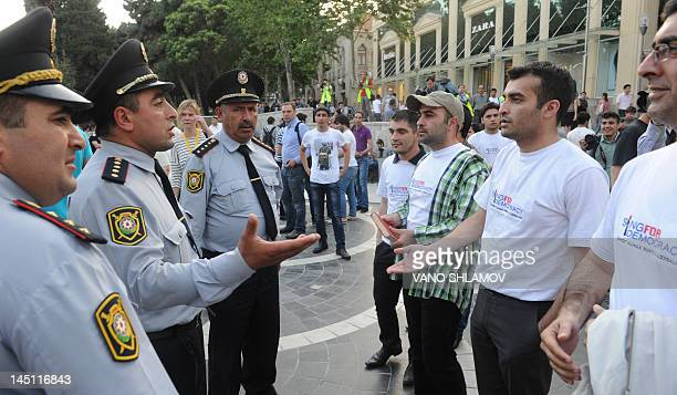 Protesters argue wiith police officers during an opposition rally in the Azerbaijan's capital Baku on May 23 2012 As Eurvision song contest hopefuls...