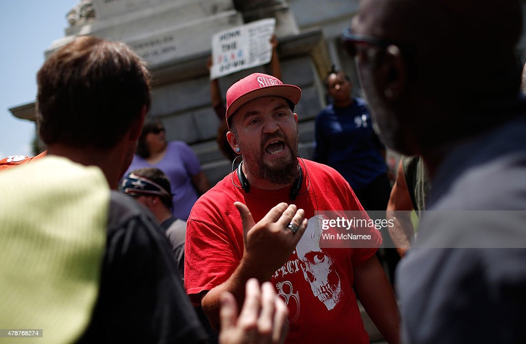 Protesters argue with a group of demonstrators on the grounds of the South Carolina State House while calling for the Confederate flag to remain on the State House grounds June 27, 2015 in Columbia, South Carolina. Earlier in the week South Carolina Gov. Nikki Haley expressed support for removing the Confederate flag from the State House grounds in the wake of the nine murders at Mother Emanuel A.M.E. Church in Charleston, South Carolina.