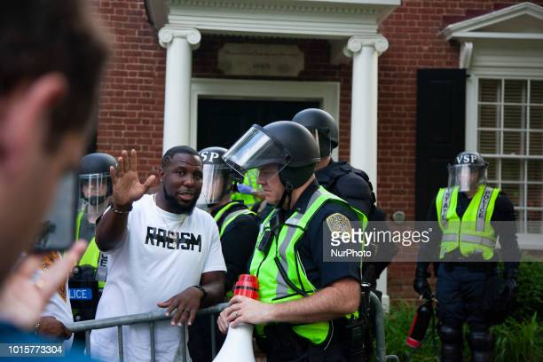 Protesters argue with police before a march left from the University of Virginia Campus in Charlottesville Virginia US on 12 August 2018 Last year...