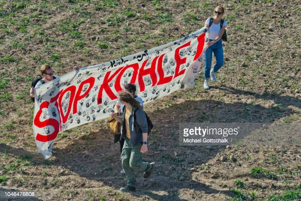 Protesters arrive with a banner reading 'stop coal' or 'Stop Kohle' to demonstrate against the clearance of Hambach forest to make way for the...