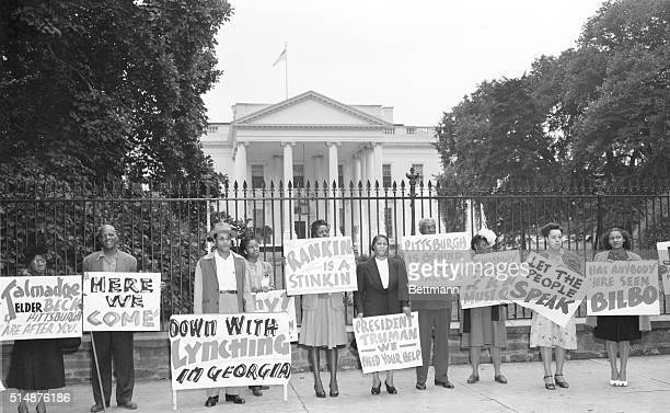 Protesters ask President Truman to do something about the latest lynching which has taken place in Monroe Georgia The protesters' sings mention...
