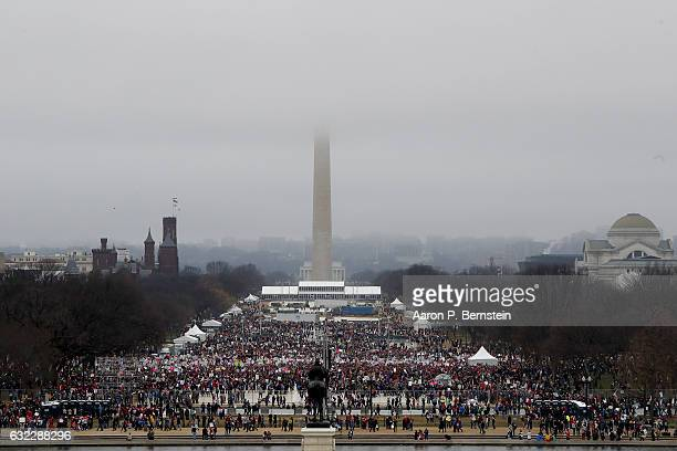 Protesters assemble on the National Mall during the Women's March on Washington January 21 2017 in Washington DC The march is expected to draw...
