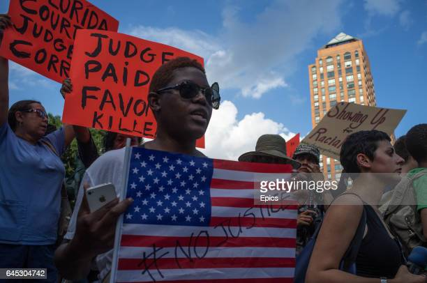 Protesters at a rally honoring Trayvon Martin at Union Square in Manhattan in New York City. George Zimmerman was acquitted of all charges in the...