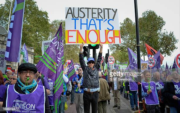 CONTENT] Protesters at a trade union march against austerity and government cuts One man in the centre of the photo is holding up a placard that...