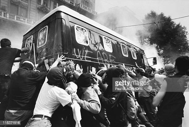 Protesters attack an Italian police vehicle during protests against the 27th Group of Eight Summit in July 2001 in Genoa Italy Hundreds of thousands...