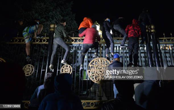 TOPSHOT Protesters attempt to break through the gates of the government headquarters during a rally against the results of a parliamentary vote in...