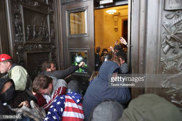 Protesters attempt to enter the U.S. Capitol Building on January 06, 2021 in Washington, DC. Pro-Trump protesters entered the U.S. Capitol building...