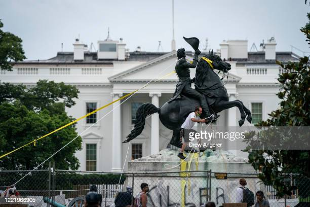 Protesters attempt to pull down the statue of Andrew Jackson in Lafayette Square near the White House on June 22 2020 in Washington DC Protests...