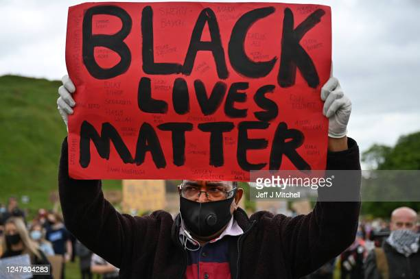Protesters attend a Black Lives Matter demonstration against racism and police brutality despite a call by First Minister Nicola Sturgeon and others...