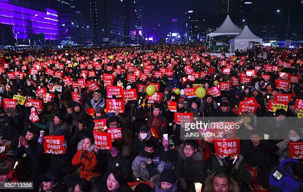 Protesters attend a candlelit rally calling for South Korean President Park GeunHye's immediate departure from her office in downtown Seoul on...