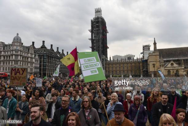 Protesters attend a Climate emergency protest in Parliament Square outside the Houses of Parliament on May 01 2019 in London England The protest was...
